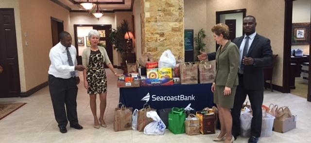 Seacoast Bank and Club 100 Charities Partner in Thanksgiving Food drive.